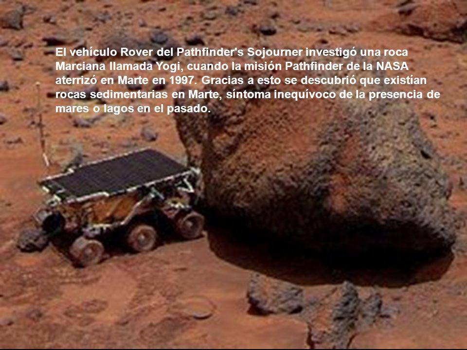 El vehículo Rover del Pathfinder s Sojourner investigó una roca Marciana llamada Yogi, cuando la misión Pathfinder de la NASA aterrizó en Marte en 1997.
