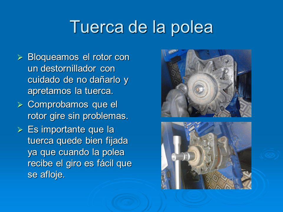 Tuerca de la poleaBloqueamos el rotor con un destornillador con cuidado de no dañarlo y apretamos la tuerca.