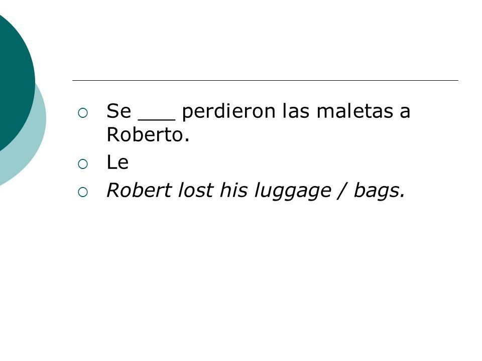 Se ___ perdieron las maletas a Roberto.