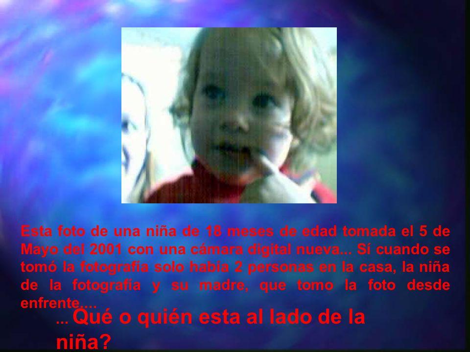 Esta foto de una niña de 18 meses de edad tomada el 5 de Mayo del 2001 con una cámara digital nueva... Sí cuando se tomó la fotografía solo había 2 personas en la casa, la niña de la fotografía y su madre, que tomo la foto desde enfrente....