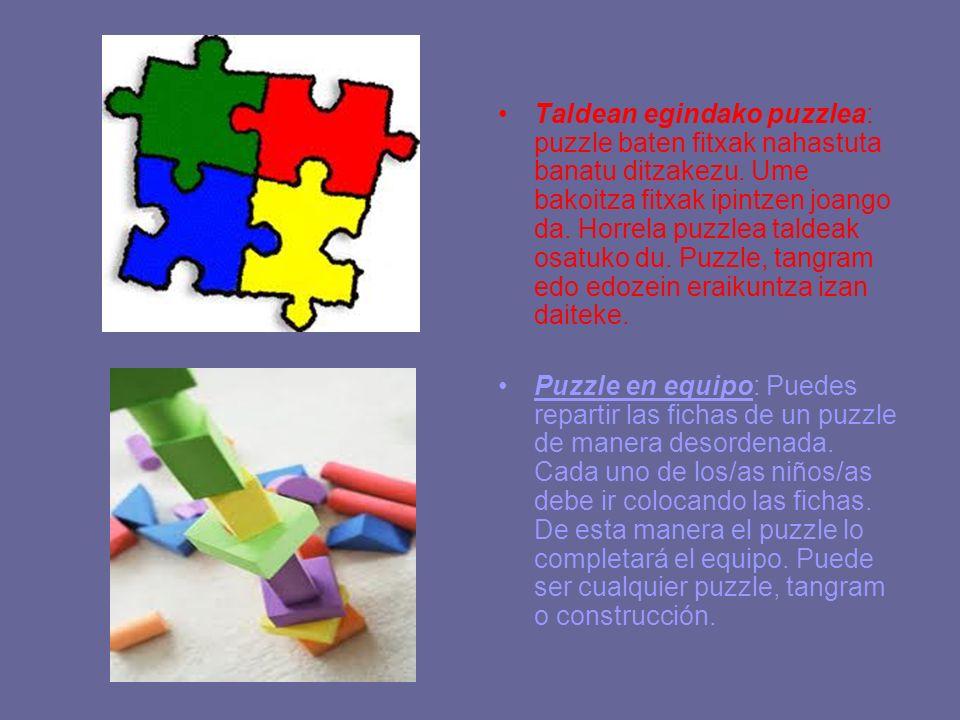 Taldean egindako puzzlea: puzzle baten fitxak nahastuta banatu ditzakezu. Ume bakoitza fitxak ipintzen joango da. Horrela puzzlea taldeak osatuko du. Puzzle, tangram edo edozein eraikuntza izan daiteke.