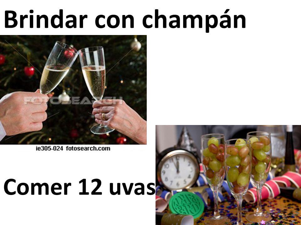 Brindar con champán Comer 12 uvas