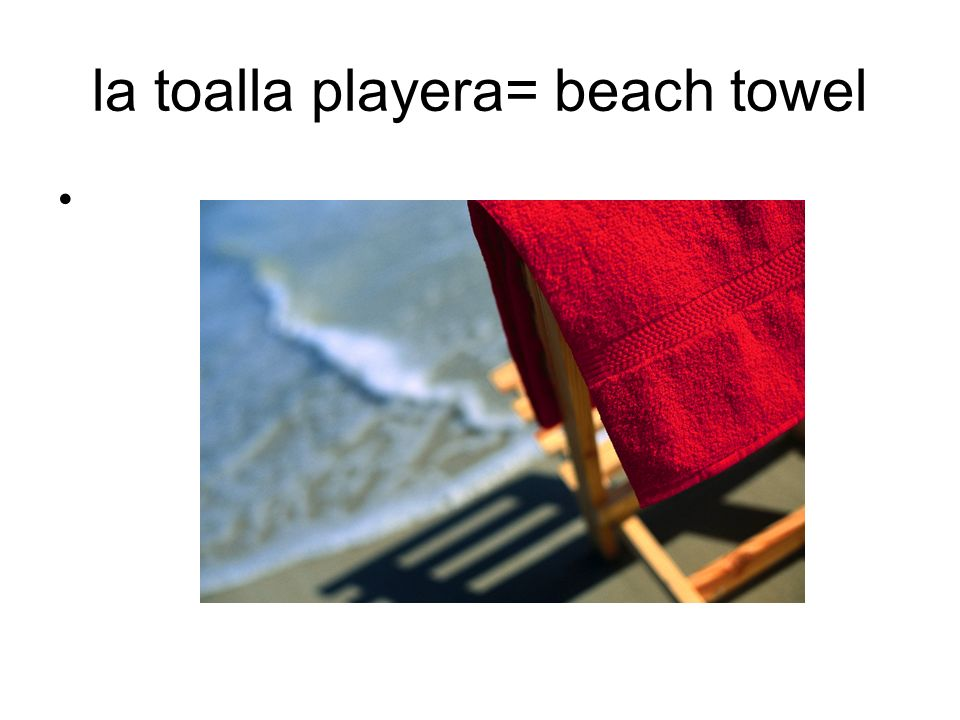 la toalla playera= beach towel