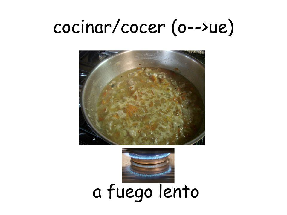 cocinar/cocer (o-->ue)