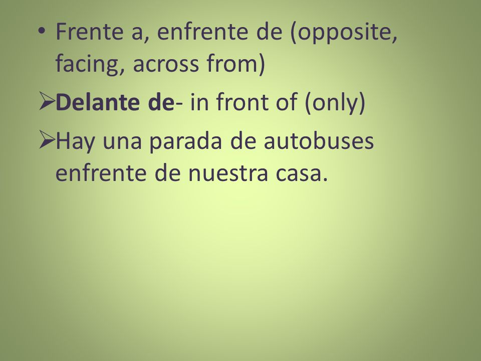 Frente a, enfrente de (opposite, facing, across from)
