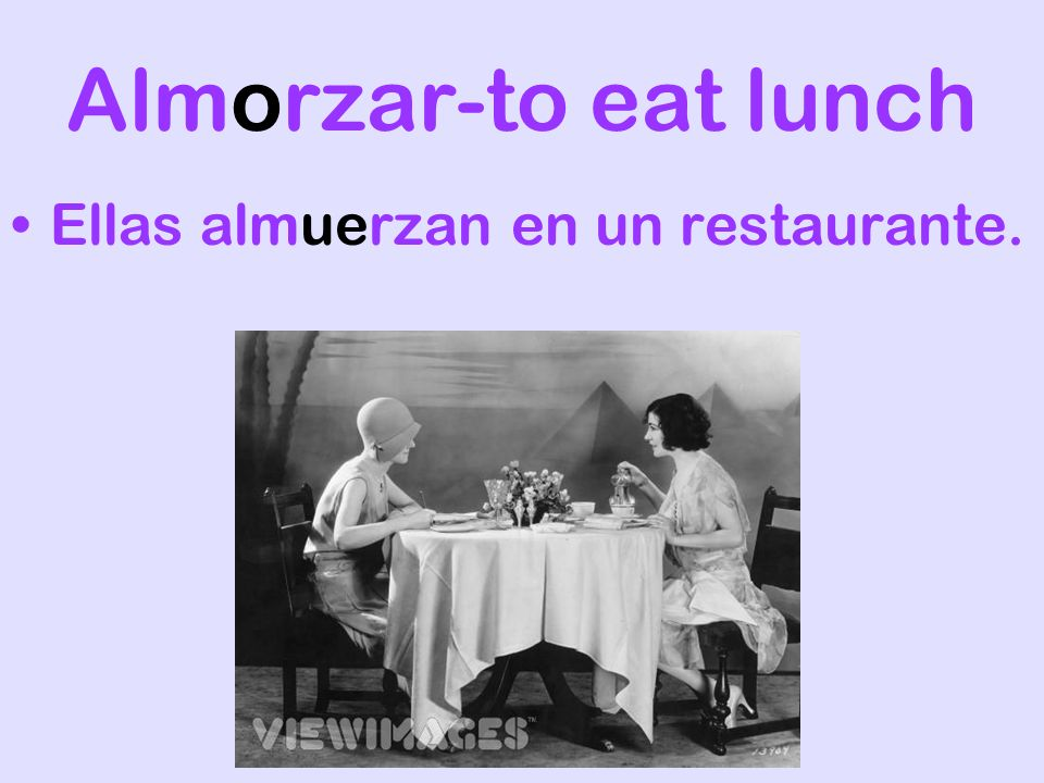 Almorzar-to eat lunch Ellas almuerzan en un restaurante.
