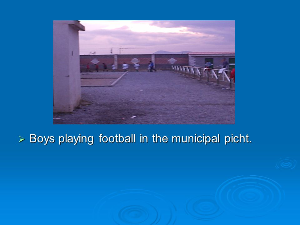 Boys playing football in the municipal picht.