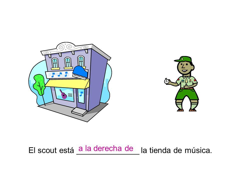 a la derecha de El scout está ______________ la tienda de música.