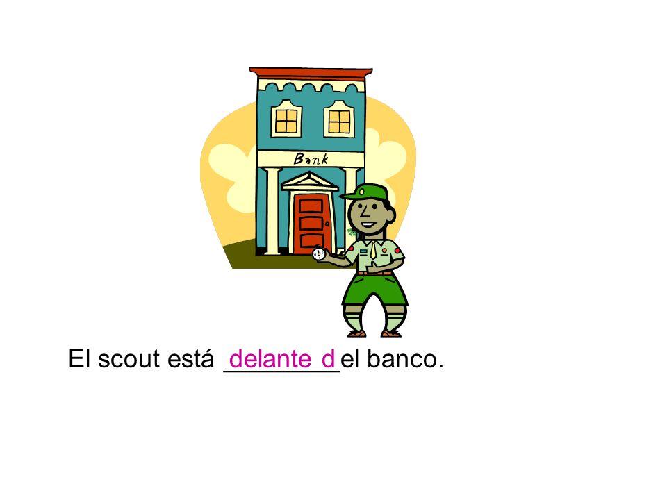 El scout está ________el banco.