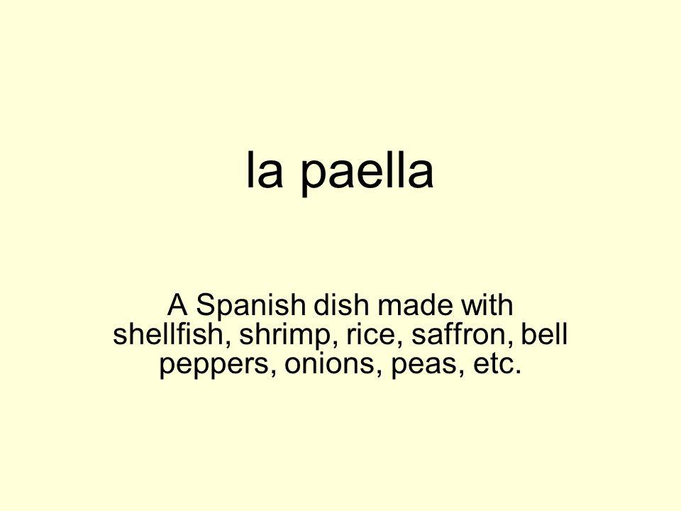 la paellaA Spanish dish made with shellfish, shrimp, rice, saffron, bell peppers, onions, peas, etc.