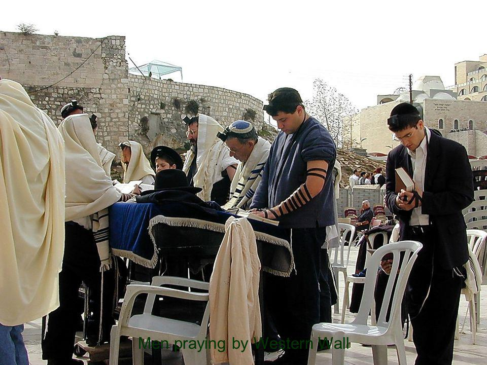 Men praying by Western Wall