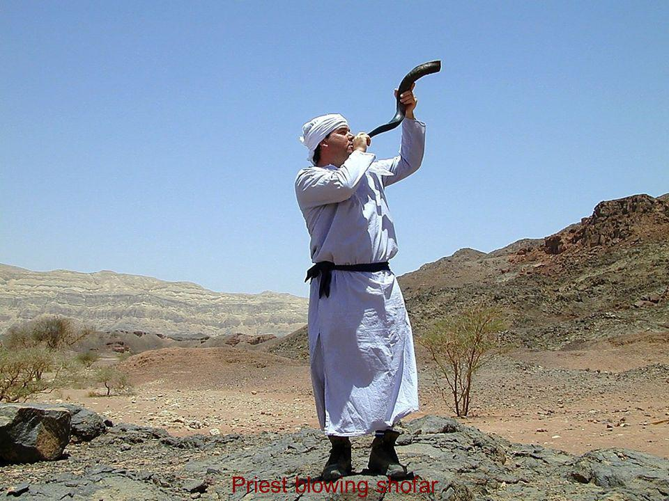 Priest blowing shofar Priest blowing shofar