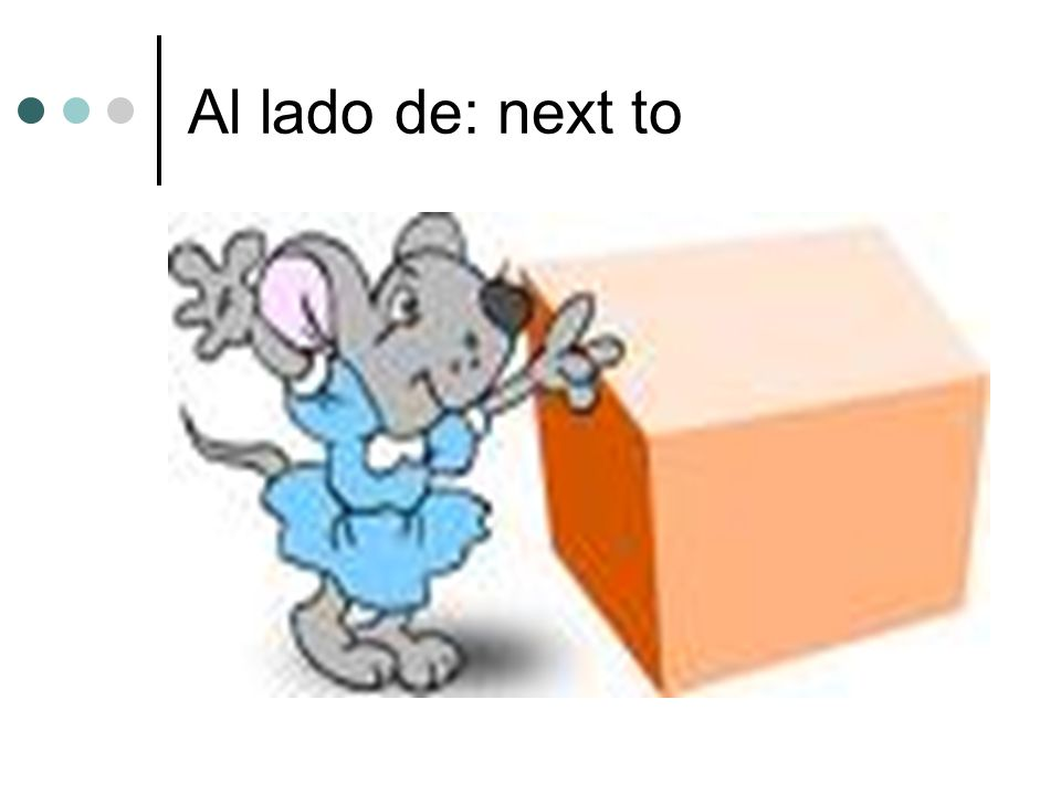 Al lado de: next to